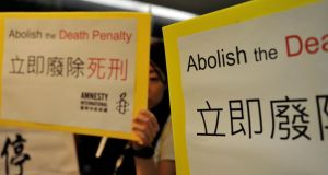 Amnesty activists protest in Hong Kong against the death penalty. China keeps the number of people it executes secret but it is thought to impose the final sanction in thousands of cases every year. Photograph: Laurent Fievet/AFP/Getty Images