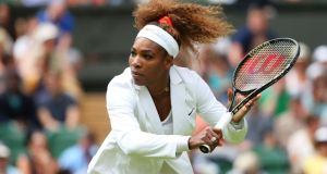 Serena Williams of the United States of America plays a backhand during the warm-up before her 6-1 6-3 first round victory over  Mandy Minella of Luxembourg at Wimbledon yesterday. Photograph: Julian Finney/Getty Images