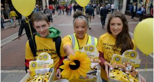 Volunteers for Irish Hospice Sunflower Day photographed on Grafton Street earlier this year from left Mark O'Donnell Elizabeth Mary Donnelly and Leah Whelan. Photograph: Brenda Fitzsimons / The Irish Times