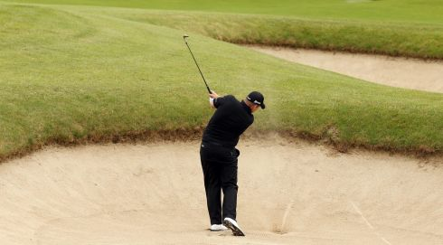 Shane Lowry plays from a fairway bunker on practice day for the Irish Open. Photograph: Cathal Noonan/Inpho