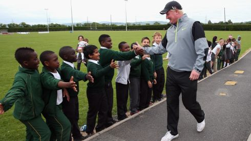 Richard Finch of England is welcomed at St Patrick's National School. Photograph: Andrew Redington/Getty Images