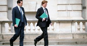Britain's chancellor of the exchequer George Osborne and chief secretary to the treasury Danny Alexander leave the Treasury for the House of Commons ahead of the chancellor  delivering a spending review. Photograph: Stefan Rousseau/Reuters.