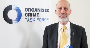 Northern Ireland Justice Minister David Ford with the Organised Crime Task Force annual report. Photograph: Lesley-Anne McKeown/PA Wire