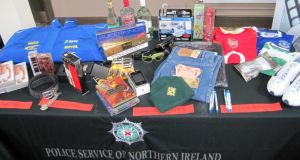Some of the counterfeit goods seized by police and customs officials in Northern Ireland on show at the Organised Crime Task Force annual report launch at the Crumlin Road jail complex today. Photograph:  Lesley-Anne McKeown/PA Wire