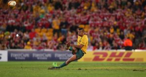 Australia's Kurtley Beale slips  while kicking the last-minute penalty in the first Test defeat to the British and Irish Lions in Brisbane. Photograph:  Chris Hyde/Getty Images