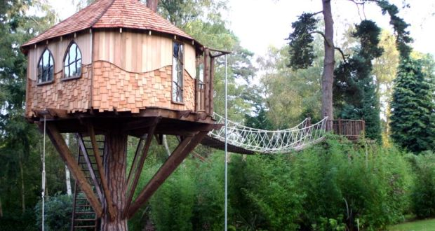 custom built cedar clad treehouse by blue forest project costs from 50000