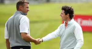 Rory McIlroy shakes hands with former Russian international Andriy Shevchenko following today's pro-am prior to the start of the Irish Open at Carton House in Maynooth. Photograph: Andrew Redington/Getty Images