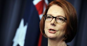 Julia Gillard, Australia's outgoing prime minister, speaks to journalists following her defeat in the   leadership ballot in Canberra yesterday.  Photograph: Mark Graham/Bloomberg