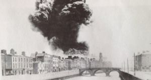 'A photograph of the aftermath, taken from Watling Street Bridge, shows the giant plume that rose from the Four Courts that day. In an incidental foreground detail, it also depicts a row of houses that included No 6 Ushers Island.'