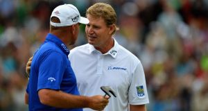 Ernie Els is congratulated by Thomas Bjorn on Eichenried's  18th. Photograph: Warren Little/Getty Images