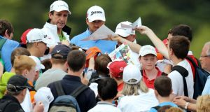 Graeme McDowell signs autographs for fans during the Pro-Am at Carton House. Photograph:  Cathal Noonan/Inpho