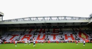 Liverpool fans hold up a mosiac in tribute to the Hillsborough disaster before the Barclays Premier League match between Liverpool and Manchester United at Anfield last September.  Photograph: Michael Regan/Getty Images