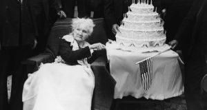 Irish-born American labour organizer Mother Jones (Mary Harris Jones 1830 - 1930) poses with a five-tiered cake in celebration of her 100th birthday, May 1st, 1930.  Ger O'Mahony of the Spirit of Mother Jones Festival Committee based in Cork said Ms Aspinall through her work as the Chairperson of the Hillborough Family Support Group was a worthy winner of the inaugural Spirit of Mother Jones Award. Photograph: FPG/Getty Images