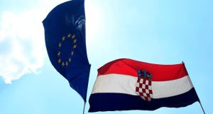 The European Union and Croatian flags wave in the wind. On July 1st Croatia will become the 28th member of the EU. Photograph: Antonio Bronic/Reuters