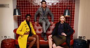 Models L'Or Mayo, wearing an Orla Kiely yellow coat and navy velvet dress, Eider Leite wearing a Richard James grey suit and shirt and Sarah Morrissey, wearing a Missoni navy cardigan and pencil skirt at the launch of Arnotts autumn winter 2013 collections. Photograph: Alan Betson
