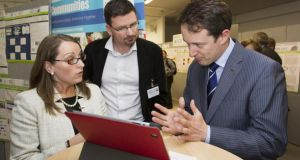Dr Jacinta Browne of DIT with co-researcher Prof Andrew Fagan of St James's Hospital and Minister Sean Sherlock.