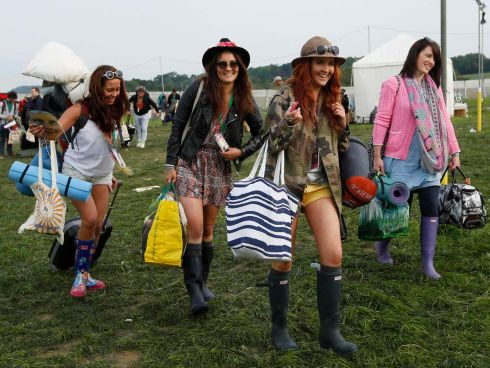 Festival goers arrive at the campsite. Photograph: Olivia Harris/Reuters