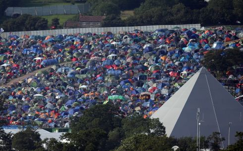 Tents begin to fill the fields. The festival, which started in 1970 when several hundred hippies paid £1 to watch Marc Bolan, now attracts more than 175,000 people over five days.  Photograph: Matt Cardy/Getty Images