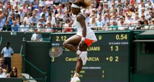 Serena Williams  in action during her match France's  Caroline Garcia  at Wimbledon. Photograph: Stefan Wermuth/Reuters