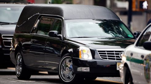 A hearse carrying the body of actor James Gandolfini arrives at the Cathedral Church of St John The Divine in New York. Gandolfini died in Rome on June 19th  after suffering a heart attack at the age of 51. Photograph: Carlo Allegri/Reuters