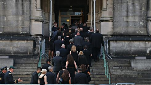Mourners make their way into the church. Photograph:  Andrew Burton/Getty Images