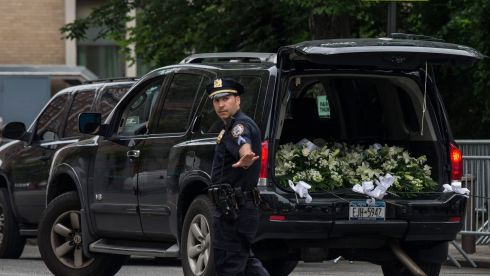 A car filled with flowers arrives prior to the funeral for actor James Gandolfini. Photograph: Andrew Burton/Getty Images