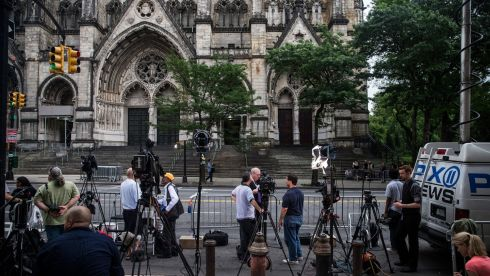 Members of the media position  outside the Cathedral Church of St John the Divine. Photograph: Andrew Burton/Getty Images