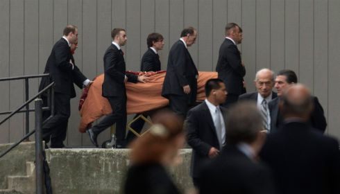 The coffin of actor James Gandolfini is escorted into the church. Photograph:  Lucas Jackson/Reuters