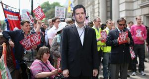A member of the public and commercial services union wears a   George Osborne face mask at a demonstration   in London yesterday against  further  cuts to public spending. Photograph: Oli Scarff/Getty Images