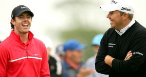 Rory McIlroy and Shane Lowry share a joke on the 3rd tee box. Photograph: Inpho/Cathal Noonan