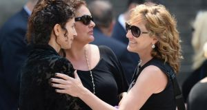 Sopranos cast members Aida Turturro (centre) and Edie Falco (right) attend the funeral of actor James Gandolfini at the Cathedral Church of St John the Divine in New York yesterday. Photograph: Mike Coppola/Getty Images