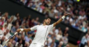 Serbia's Novak Djokovic in action against USA's Bobby Reynolds during day four of the Wimbledon Championships.