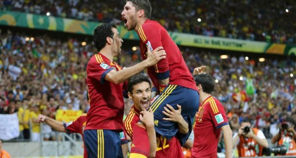 Spain's Jesus Navas (bottom) celebrates with his teammates after scoring the winning penalty  against Italy in the  shoot-out of their Confederations Cup semi-final  at the Estadio Castelao.