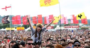 The crowd cheer for Liam Gallagher at the Other Stage during the Glastonbury music festival at Worthy Farm in Somerset, this morning. Photograph: Reuters/Olivia Harris