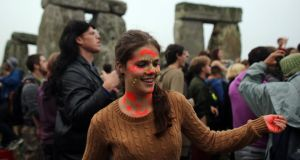 Summer solstice: people celebrate at the megalithic monument of Stonehenge, in England, last weekend; suggestions that Irish Catholics are becoming pagan have been rejected. Photograph: Matt Cardy/Getty Images