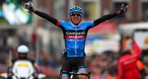 Dan Martin crosses the finish line to win the 99th Liege-Bastogne-Liege cycle road race last  April. Photograph: Bryn Lennon/Getty Images