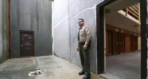 Solitary confinement: Lt Rick Graves stands in the inmates' concrete exercise yard at the Pelican Bay State Prison near Crescent City in California. Photograph: Jim Wilson/The New York Times