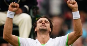 David Ferrer of Spain celebrates victory during  against Roberto Bautista Agut at Wimbledon. Photograph: Dennis Grombkowski/Getty Images