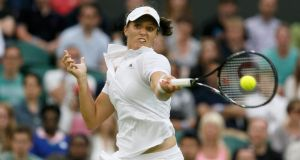 Laura Robson  hits a return to Mariana Duque-Marino of Colombia during their women's singles tennis match at the Wimbledon Tennis Championships. Photograph: Stefan Wermuth /Reuters