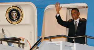 US president Barack Obama waves while arriving at Waterkloof Air Base in South Africa. Photograph: Jason Reed/Reuters