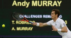 Andy Murray  hits a return on his way to victory over Tommy Robredo of Spain in their third round men's singles match at Wimbledon. Photograph: Eddie Keogh/Reuters