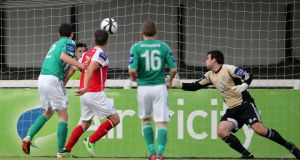 Christy Fagan scores his second goal past Bray Wanderers goalkeeper Darren Quigley.  Photograph: Cathal Noonan/Inpho