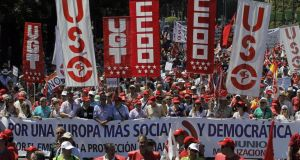 "Protesters march holding a banner reading ""For a more social and democratic Europe. More jobs and social protection"" during a demonstration in Madrid, Spain, this month. AP Photo/Andres Kudacki"
