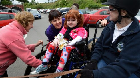 Roisin Tansey (3) from Mayo, prepares to travel by carriage. Photograph: Eric Luke / THE IRISH TIMES.
