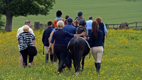 Young riders are guided through the meadow. Photograph: Eric Luke / THE IRISH TIMES.
