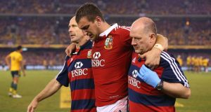 Lions captain Sam Warburton leaves the field injured. Photograph:  Cameron Spencer/Getty Images