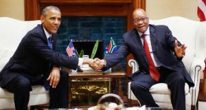 President Barack Obama  shakes hands with South Africa's president Jacob Zuma during their meeting at the Union Buildings in Pretoria, today. Photograph: Reuters