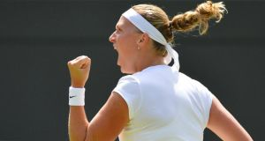 Petra Kvitova of the Czech Republic celebrates a break in serve  against Ekaterina Makarova of Russia at Wimbledon.  Photograph: Toby Melville/Reuters