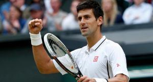 Novak Djokovic of Serbia celebrates after defeating Jeremy Chardy of France in their singles match at Wimbledon. Photograph: Eddie Keogh/Reuters