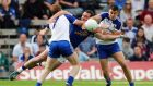 Eugene Keating of Cavan with Kieran Duffy and Drew Wylie of Monaghan battle for possession at Clones. Photograph: Donall Farmer/Inpho